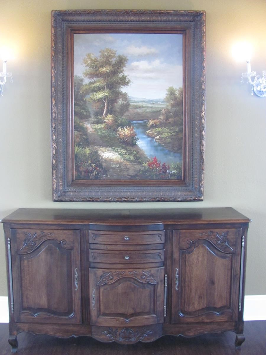 Wooden Dresser and Landscape Painting Hanging Over It
